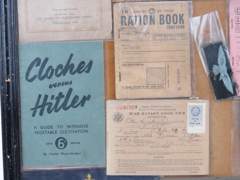 A framed montage of WWII items inc rations books, identity card, driving licence, arm bands, - Image 4 of 7