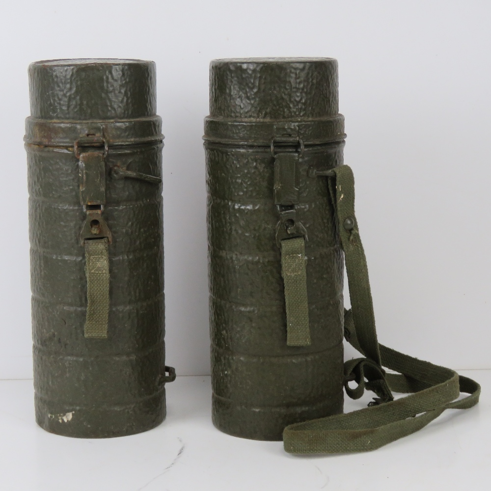Two WWII German cylindrical mess tins, one with canvas carry strap.