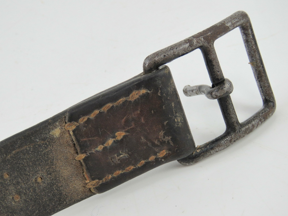 A WWII German or Russian brown leather belt. No legible markings upon. - Image 2 of 3