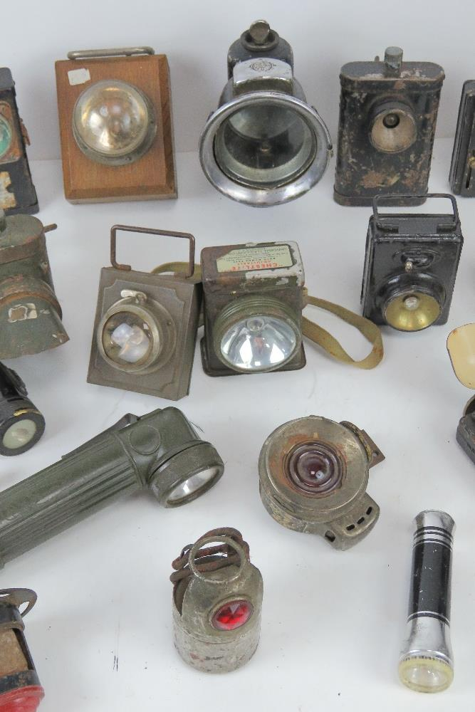A large quantity of assorted lamps and torches inc bike lamps, Air Ministry signal lamp, - Image 3 of 19