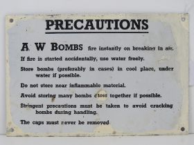 An enamelled tin plate WWII warning sign 'AW bombs fire instantly on breaking in air...