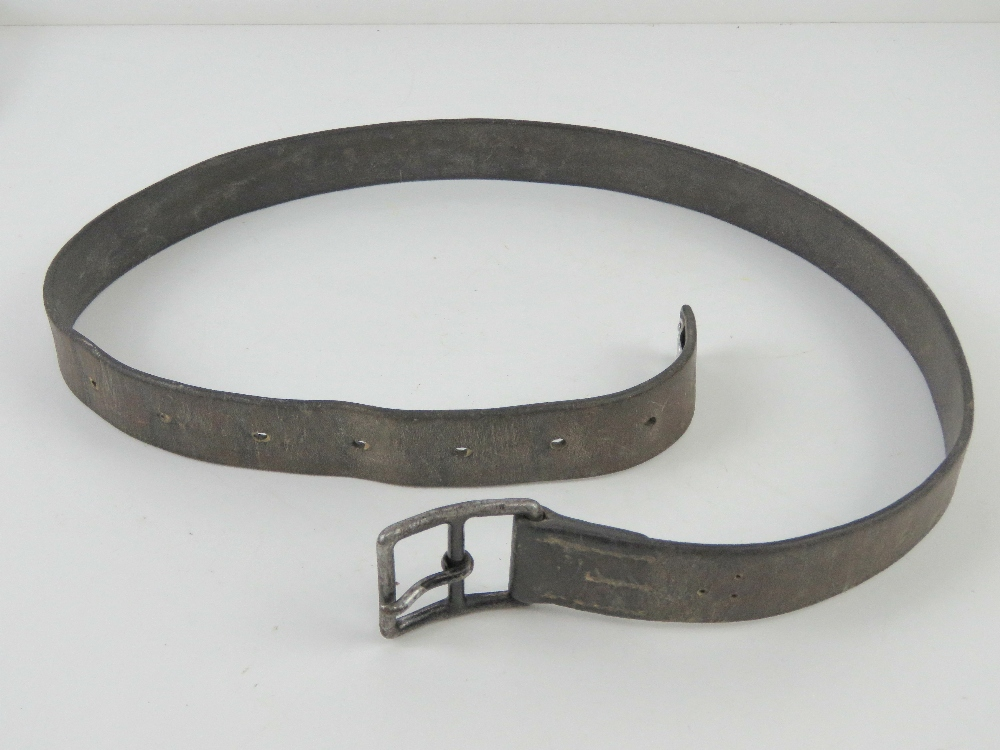 A WWII German or Russian brown leather belt. No legible markings upon.