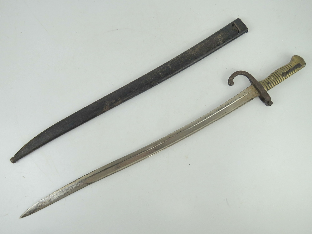 A French 1871 Pattern bayonet having 57.5cm blade, brass grip and hook quillion, with scabbard. - Image 2 of 3