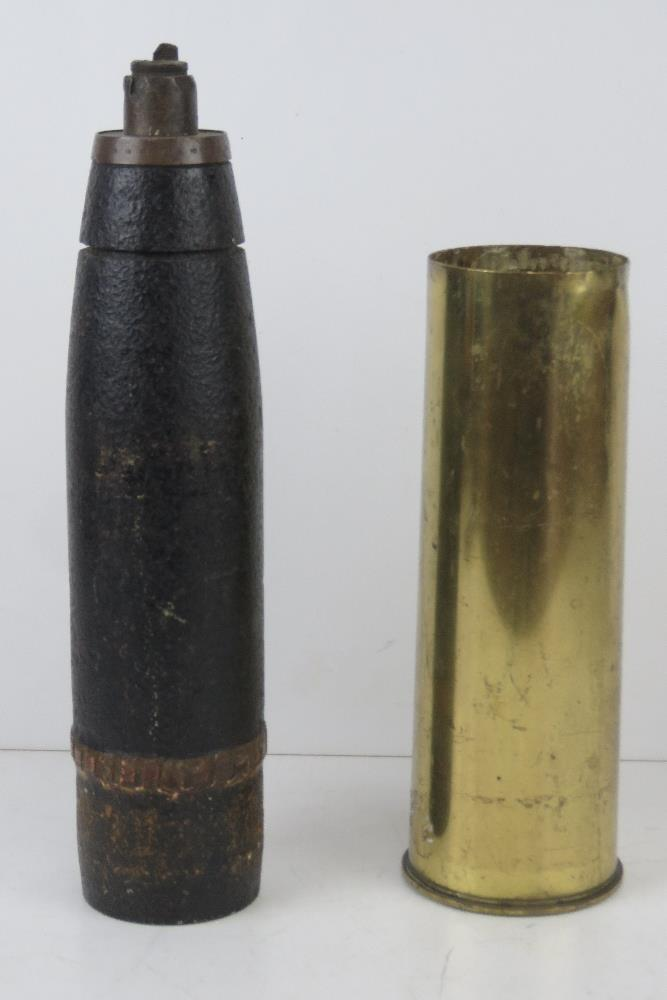 An inert WWI British shrapnel round with case, dated 1916, standing 61cm high. - Image 2 of 4