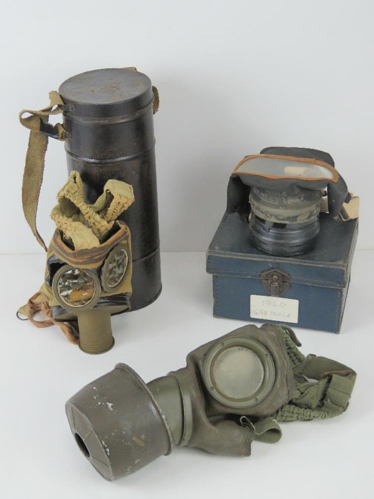 A German gas mask. Together with another gas mask, a/f, in canister.