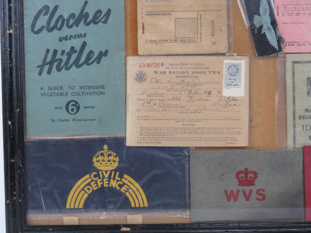 A framed montage of WWII items inc rations books, identity card, driving licence, arm bands, - Image 5 of 7