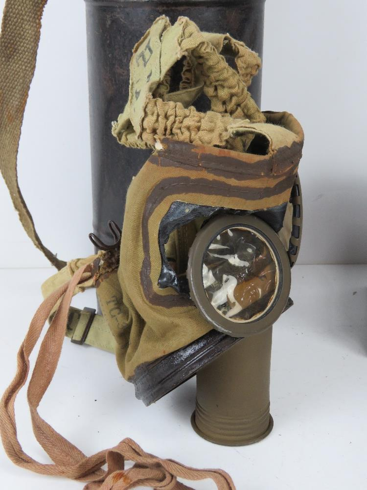 A German gas mask. Together with another gas mask, a/f, in canister. - Image 4 of 5