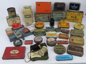 A quantity of circa WWII and later tins inc Odgens St Julian Tobacco, Horlicks tablets,
