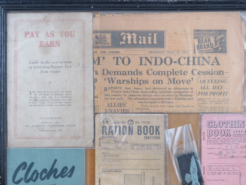 A framed montage of WWII items inc rations books, identity card, driving licence, arm bands, - Image 2 of 7