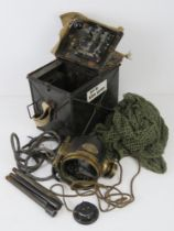 A WWI signal lamp having metal and canvas covered case having clear glass lens with green and red