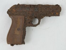 A German Officer's CZ27 pistol in relic condition.