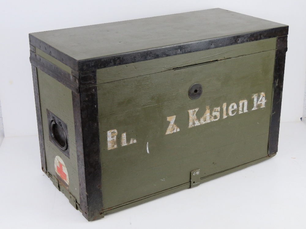 A WWII German Red Cross wooden transit case having metal end handles and bearing label Bartsch