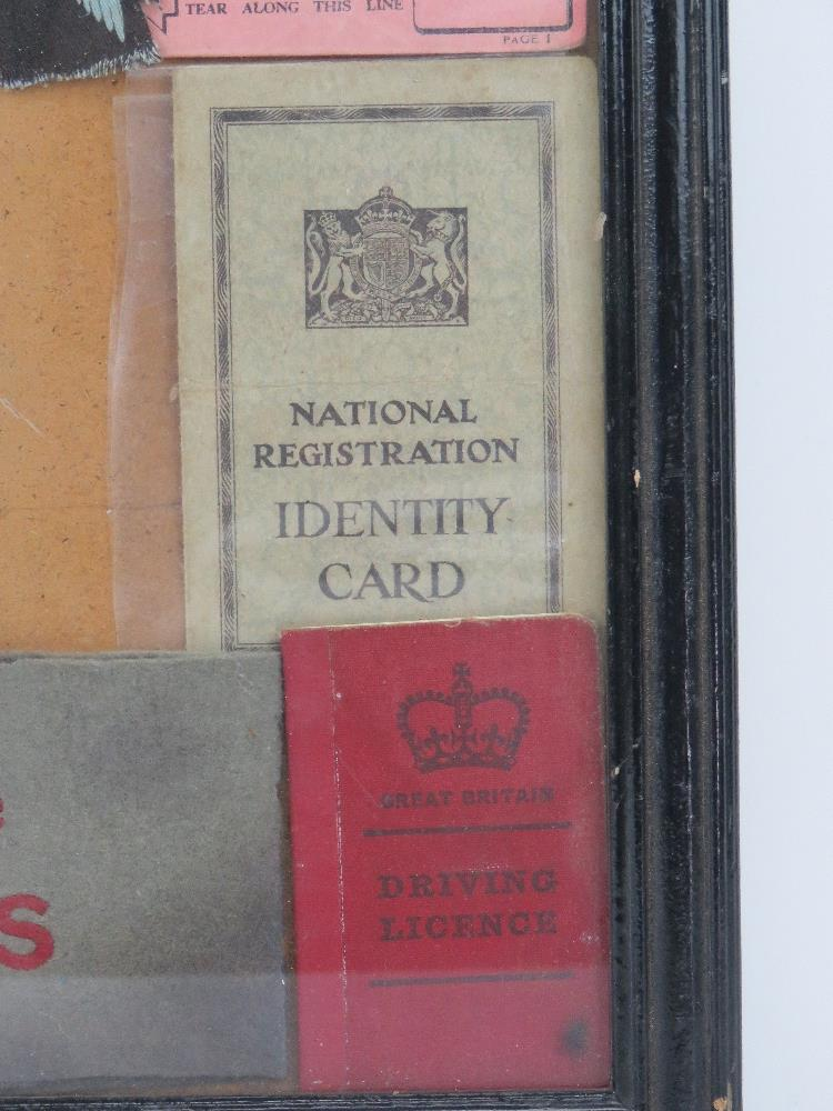 A framed montage of WWII items inc rations books, identity card, driving licence, arm bands, - Image 6 of 7