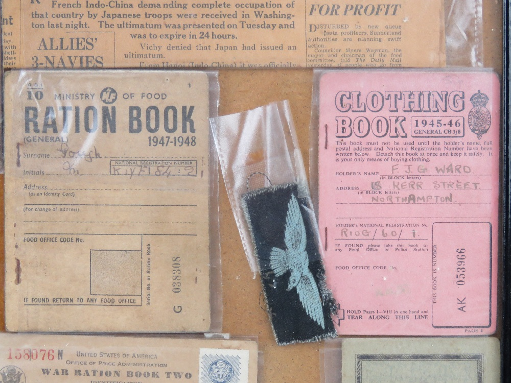A framed montage of WWII items inc rations books, identity card, driving licence, arm bands, - Image 3 of 7