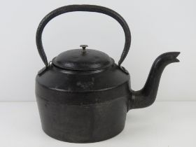 A WWII British Military cast iron kettle having broad arrow upon and dated 1942. 32.