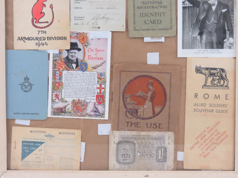 A framed montage of WWII items inc Motorfuel ration book, - Image 4 of 4