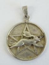 A silver leaping hare and pentagram Wiccan pendant, fertility symbol of Ostara Goddess of Spring,