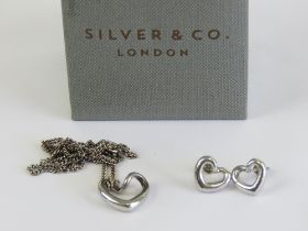 A delightful Mappin & Webb suite of HM silver jewellery comprising stud earrings and pendant on