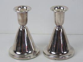 A pair of silver Christophersen short candlesticks,