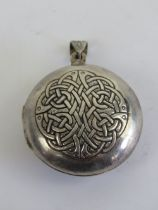 A large HM silver Celtic locket having Irish blessing and knot design upon 'May the road rise to