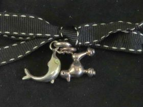 Links of London; two silver charms having Links hallmark upon in the form of a dolphin and a poodle.