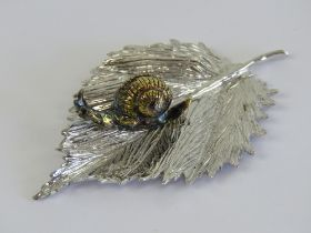 An unusual and superbly made HM silver ornament in the form of a gilded snail upon a leaf,