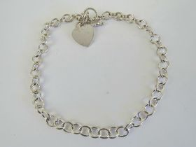 A substantial HM silver choker chain necklace having heart charm upon, T-bar clasp, hallmarked 925,