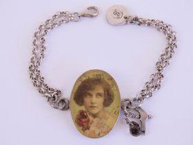 A HM silver double chain link bracelet having vintage style portrait to centre,