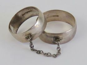 An unusual pair of HM silver Bohemian style 'slave rings' attached by chain,