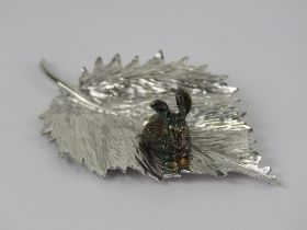 An unusual and superbly made HM silver ornament in the form of a gilded rabbit upon a leaf,