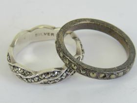 Two silver and marcasite rings, one being Sterling in plaited design size L,