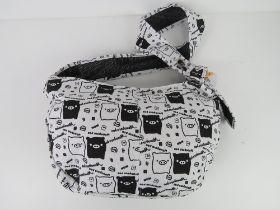 A cross body fabric bag having pig theme