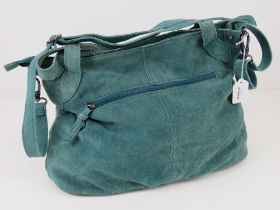 A vintage turquoise blue suede handbag.