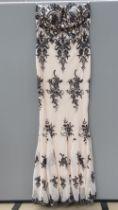 A floor length blush evening dress by Qu