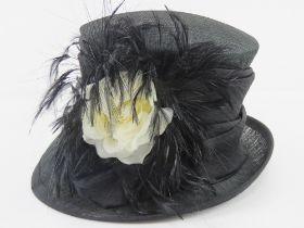 A Victoria Ann natural fibre hat having