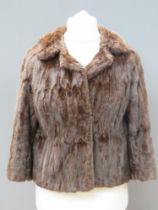 A vintage fur jacket bearing label for S
