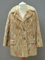 A vintage fur coat, no apparent labels,