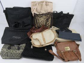 A quantity of assorted handbags.
