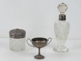 A HM silver trophy cup, together with a cut glass scent bottle having HM silver rim and a white