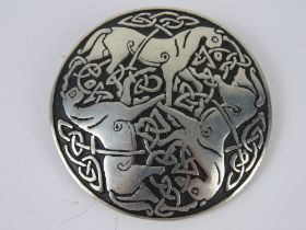 A St. Justin pewter brooch having three horses and Celtic knot design upon, 5.2cm dia.