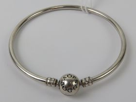 A silver Pandora charm bangle, stamped 925 ALE, 6cm internal dia, in presentation box.