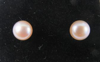 A pair of 9ct and pale pink pearl earrings with butterfly backs, stamped 9ct.