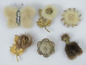 Six early 20th century fur brooches in the form of a dog, a butterfly and flowers.