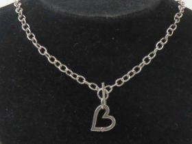 A HM silver necklace having heart pendant set with pink stone upon, T-bar clasp hallmarked 925, 40cm
