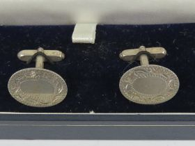 A pair of unengraved silver cufflinks in presentation box.