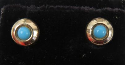 A pair of turquoise stud earrings, no apparent hallmarks, with butterfly backs.