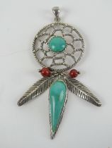 A large silver and turquoise Native American style dream catcher pendant, stamped 925 and