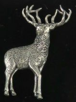 A pewter brooch in the form of a stag by AB Brown, in presentation box.