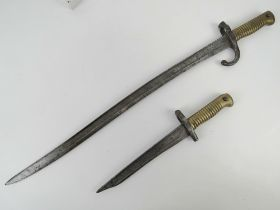 A French Chassepot 1866 pattern bayonet, together with a converted 1866 fighting knife. Two items.