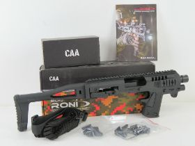 A Micro Roni Conversion System for the Glock 19 and Glock 23. CAA manufacture. New in box.